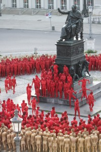 Participants get into position for photographer Spencer Tunick's Ring installation